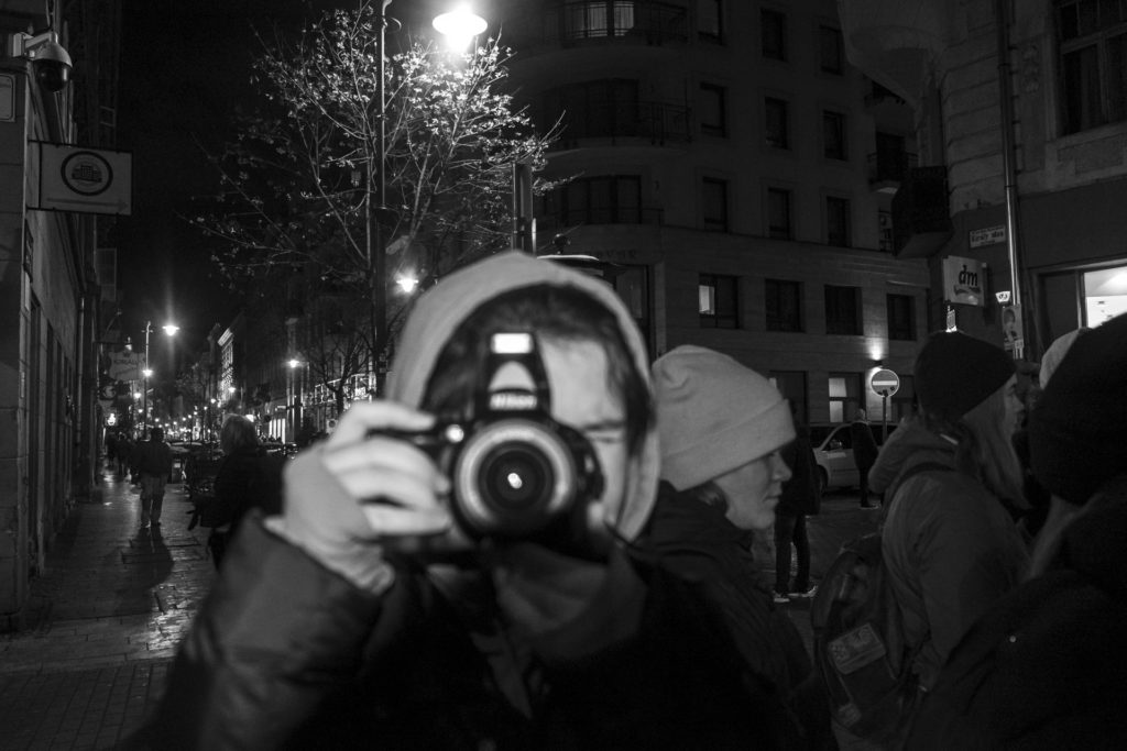 Blurry image of photographer with photo camera