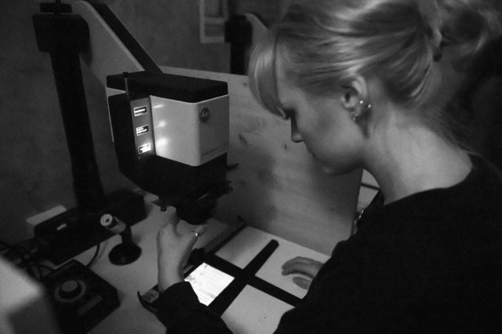 Young woman working in darkroom
