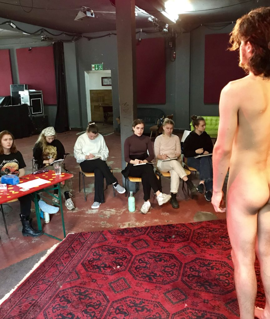 Art students and nude model