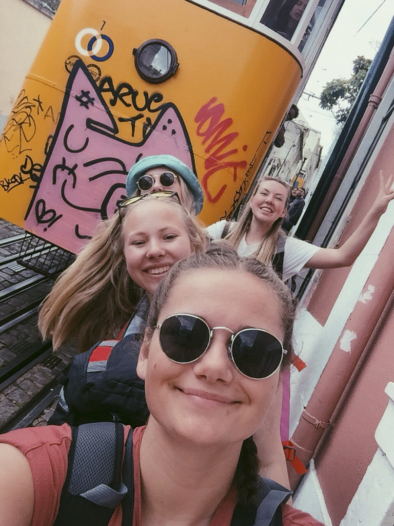 Cheerful girls traveling