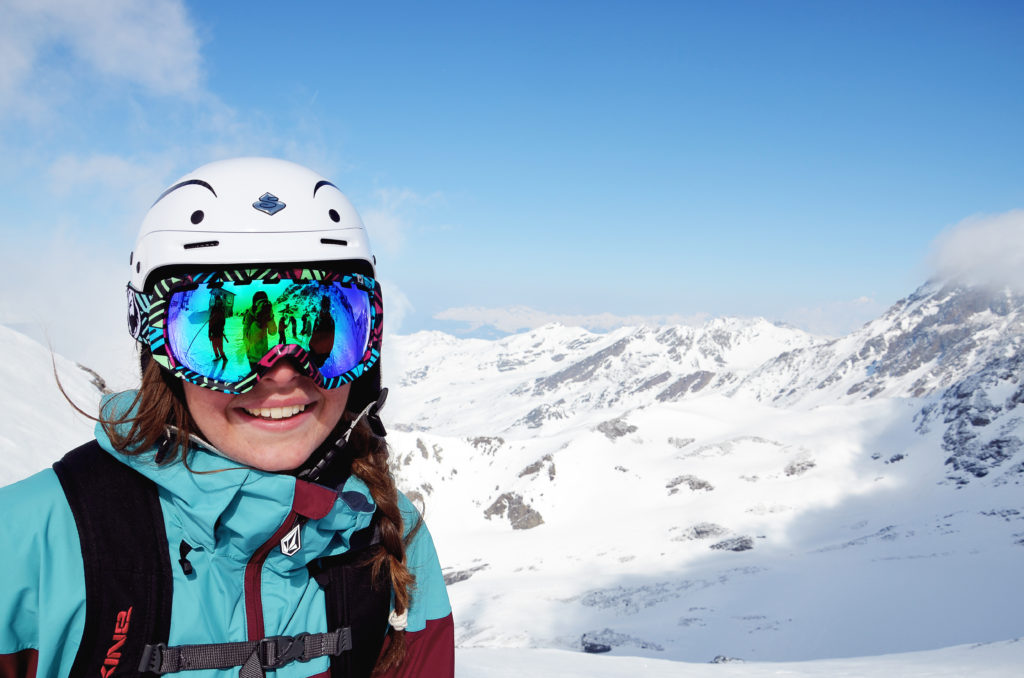Young woman posing in front of alpine mountains