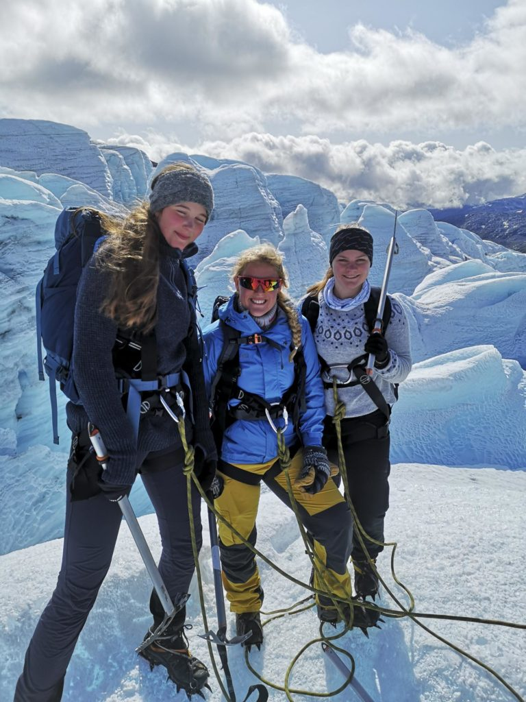 Three young people on glaciers