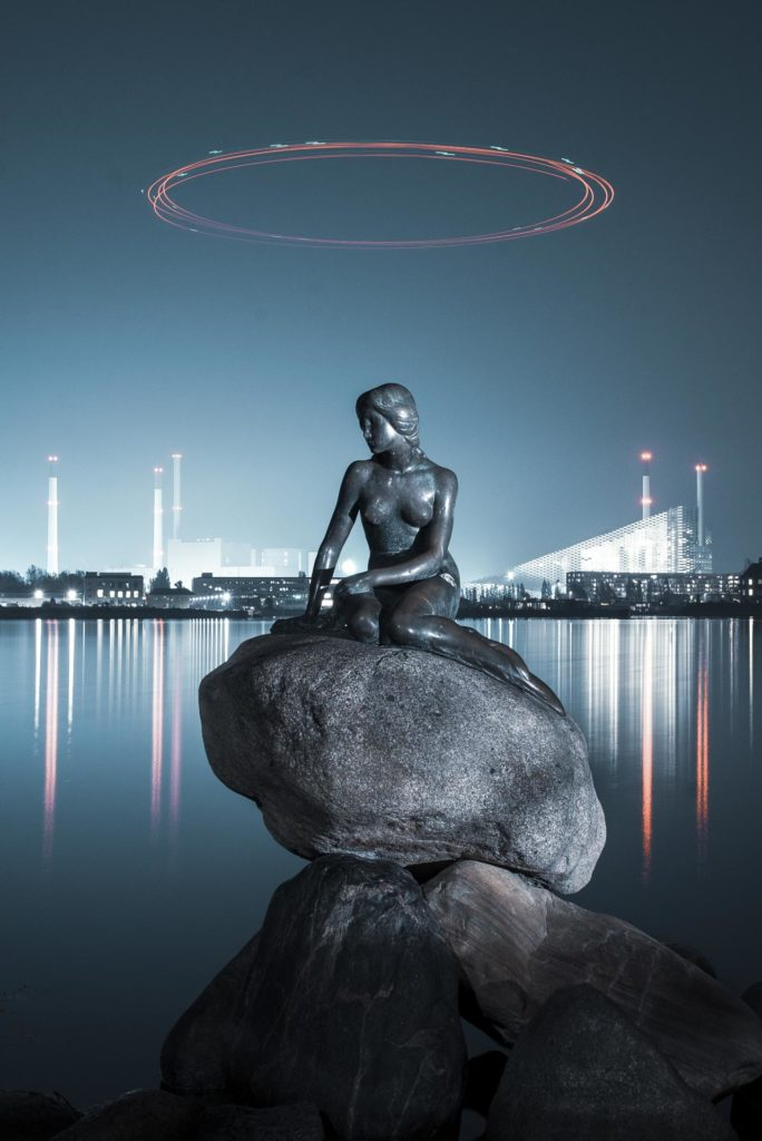 The little mermaid with a luminous circle over her head in Copenhagen