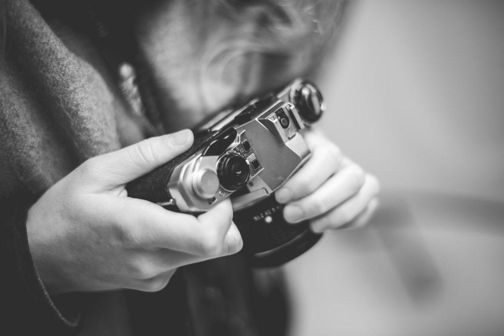 Person holding retro vintage movie camera