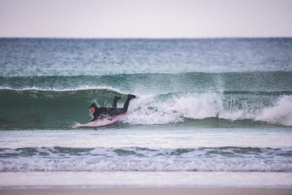 Surfing in the water on a surfboard