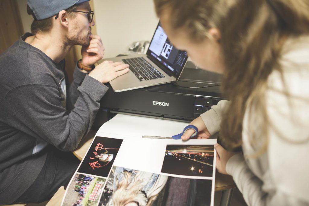 Photographers work on printing photos