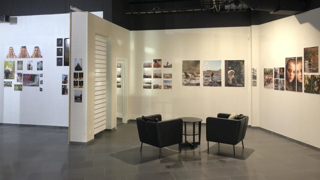 Gallery with photographs hanging on the walls