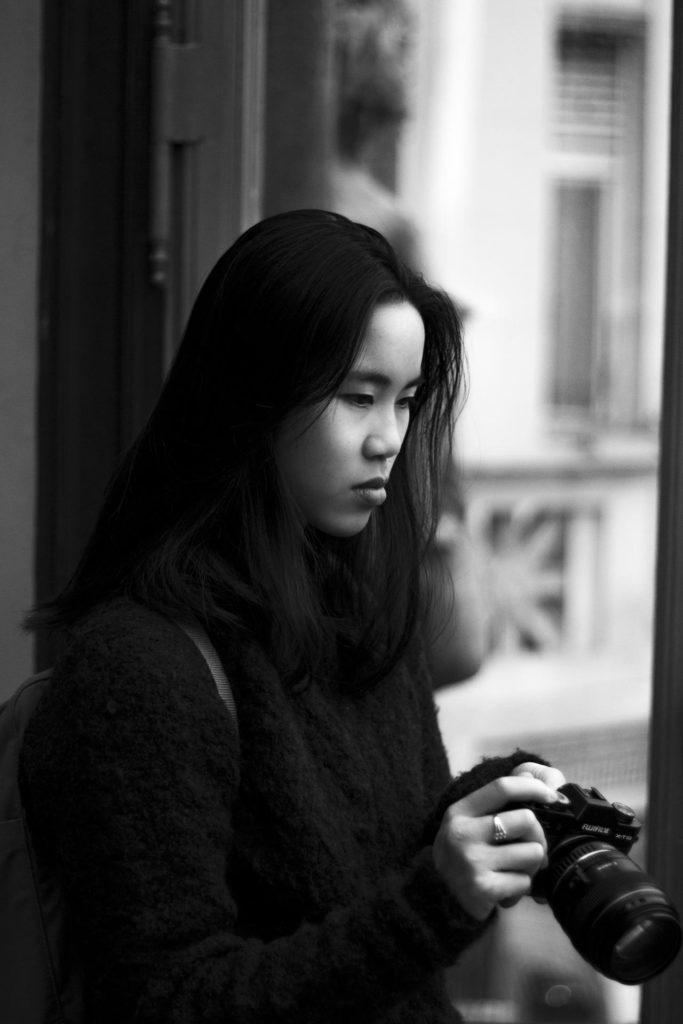 Girl posing with photo camera