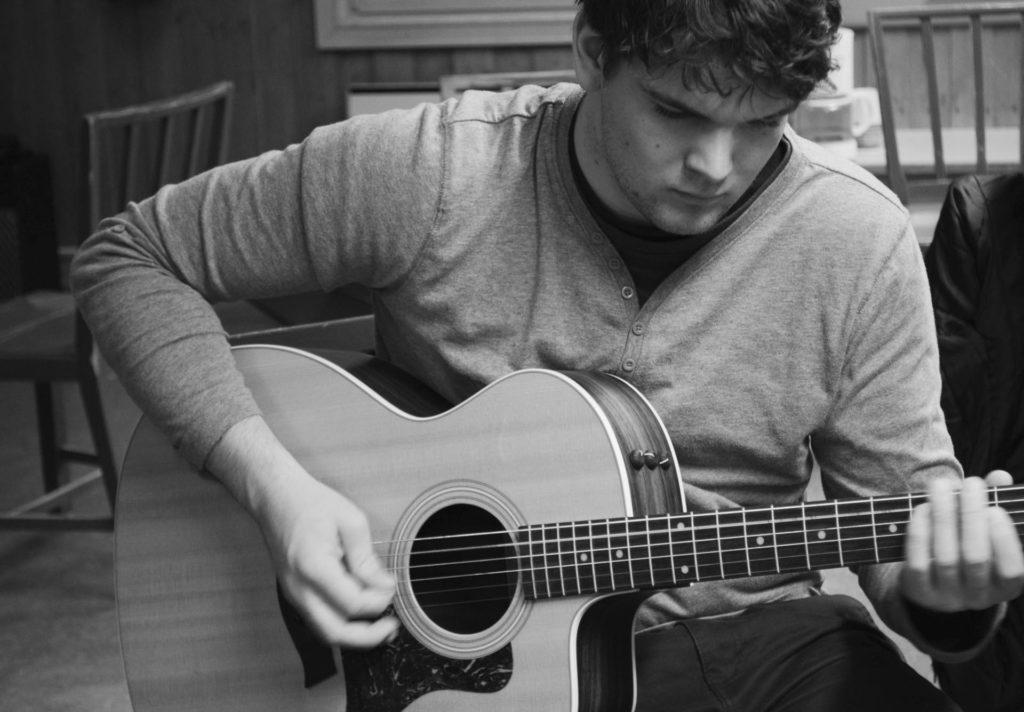 Musician practices guitar