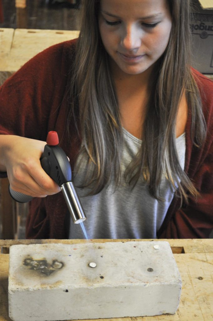 Girl melts jewelry with heat gun
