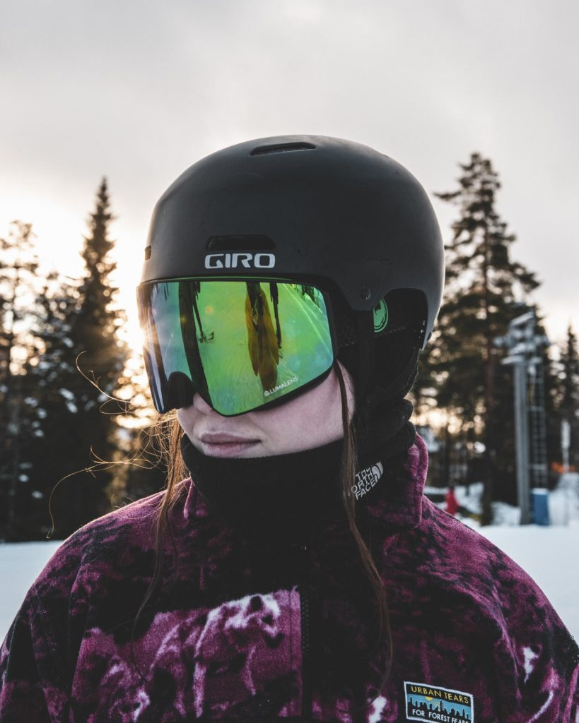 Portrait of young woman with helmet and goggles