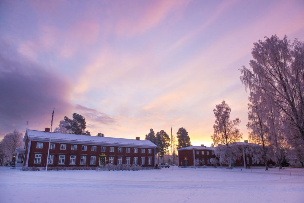 The main building at Elverum Folk High School at sunrise