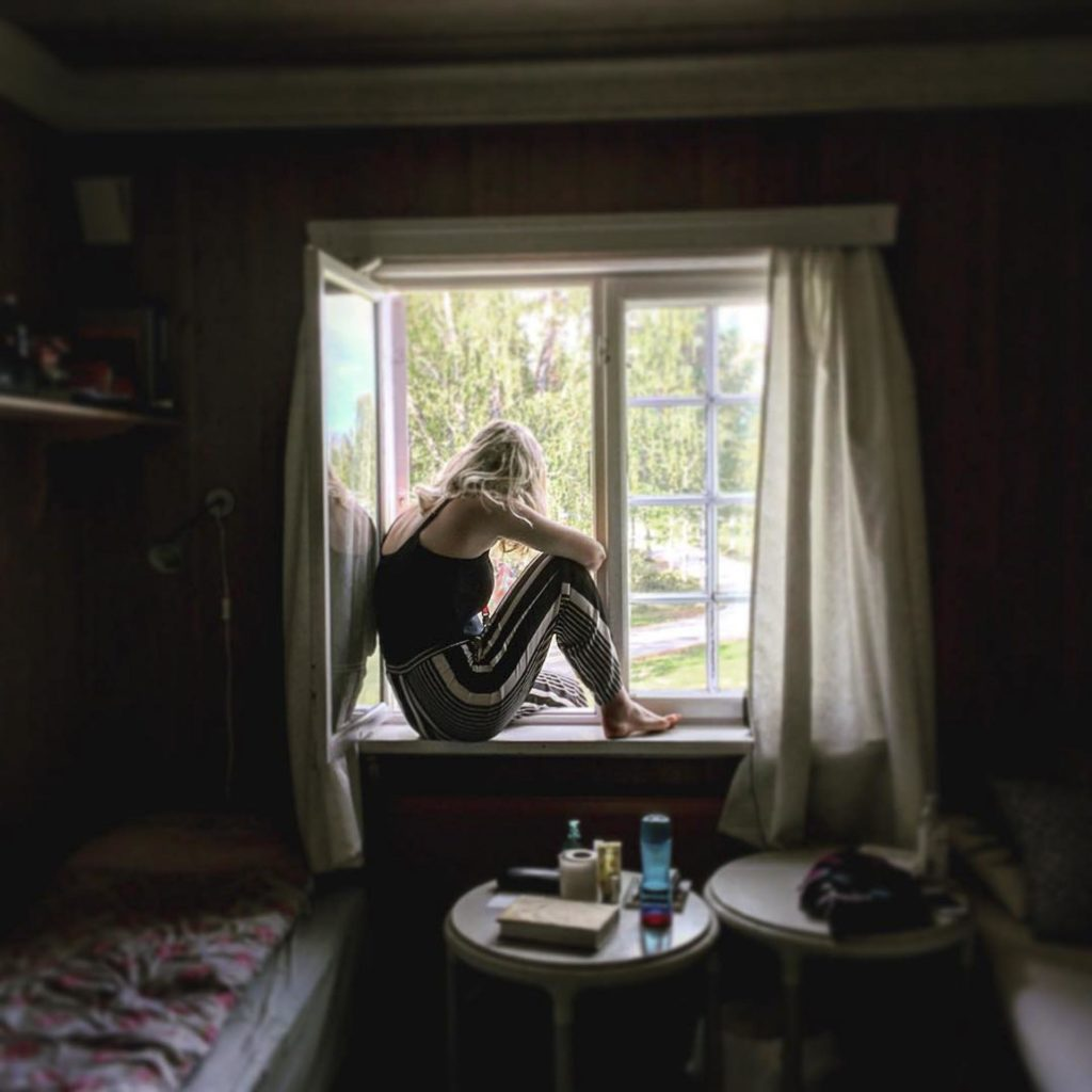Student in window at boarding school