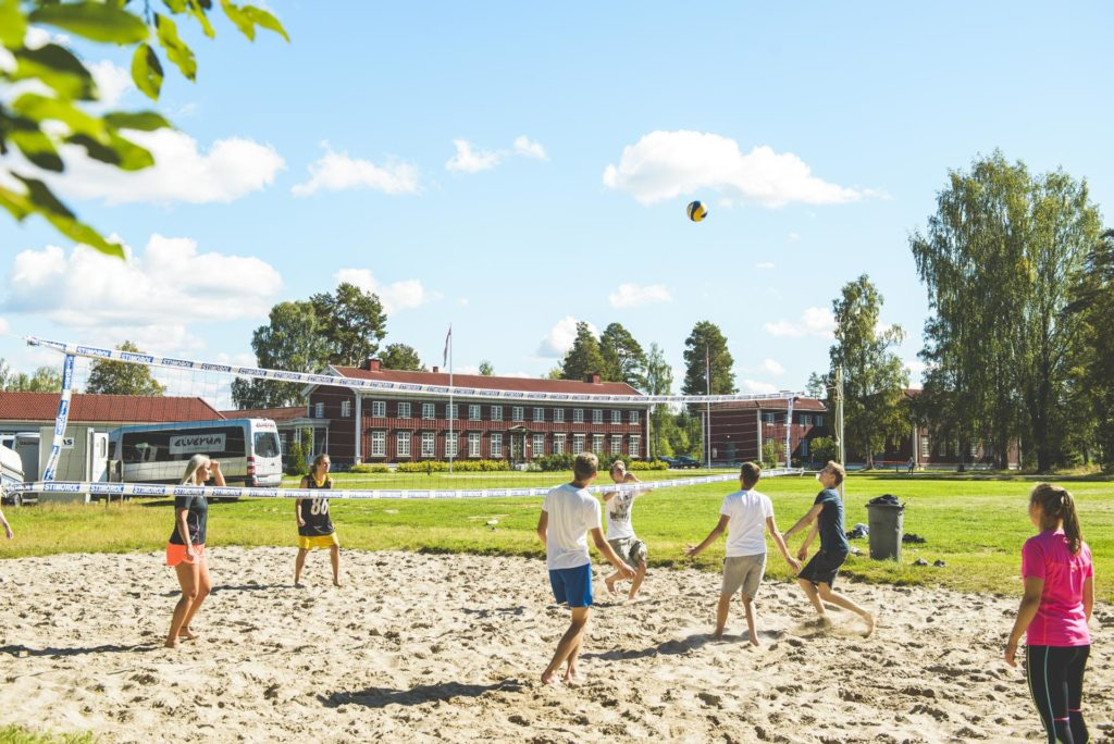 Young people play volleyball