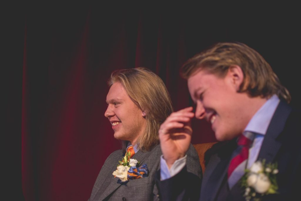 Two young men get married and smile