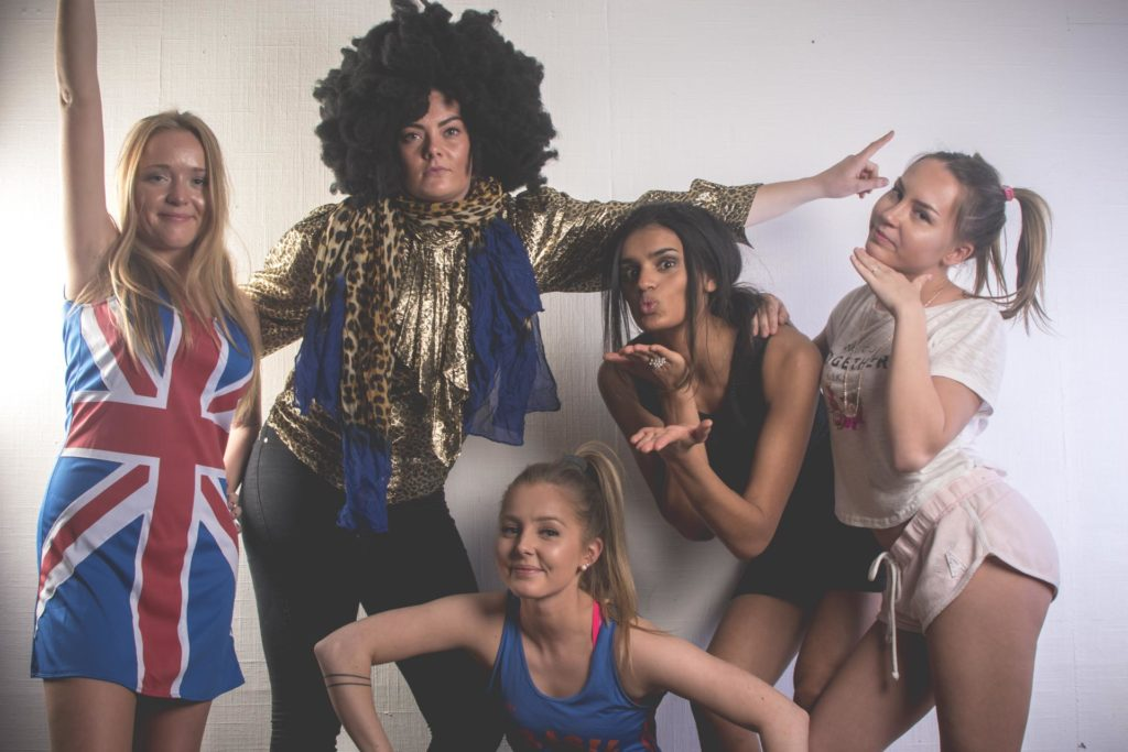 Young people have dressed up as Spice Girls and posed