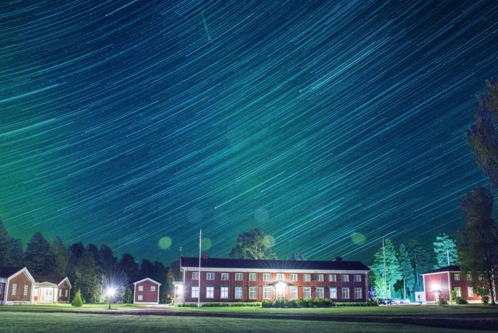 The main building at Elverum Folk High School under a starry sky