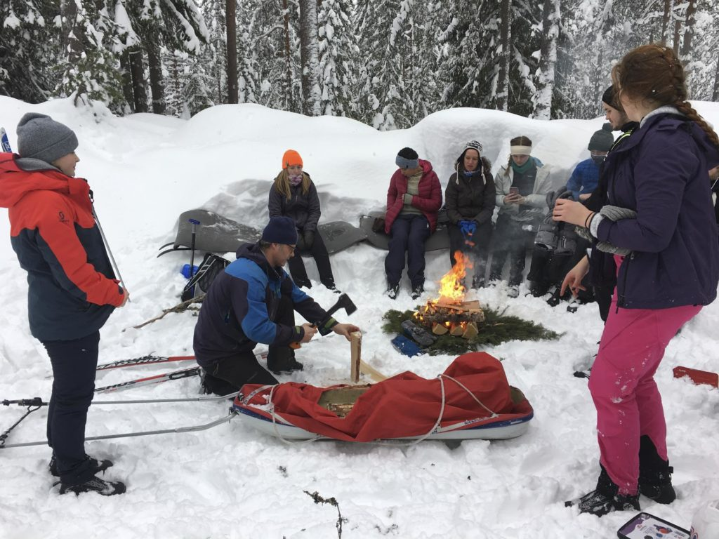 Group learns to build bonfires in the winter