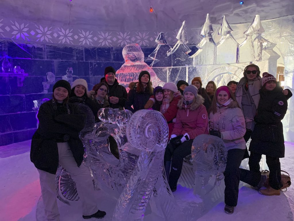 Group posing with ice sculpture