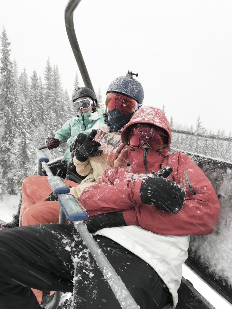Three young people in a ski lift
