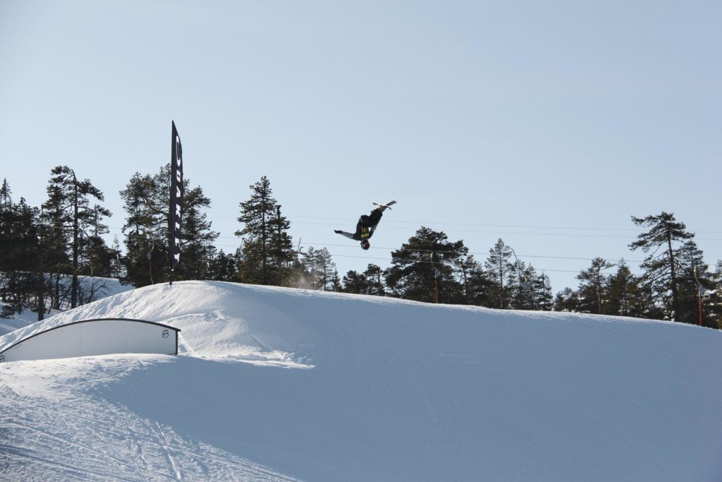 Skier in the air over big jump