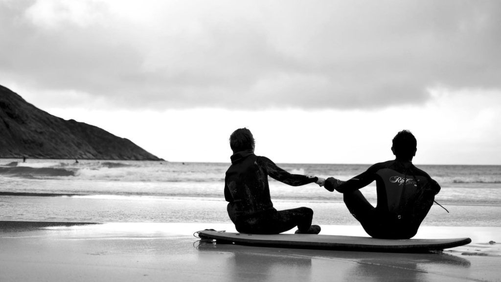 Surfers give each other the knuckle