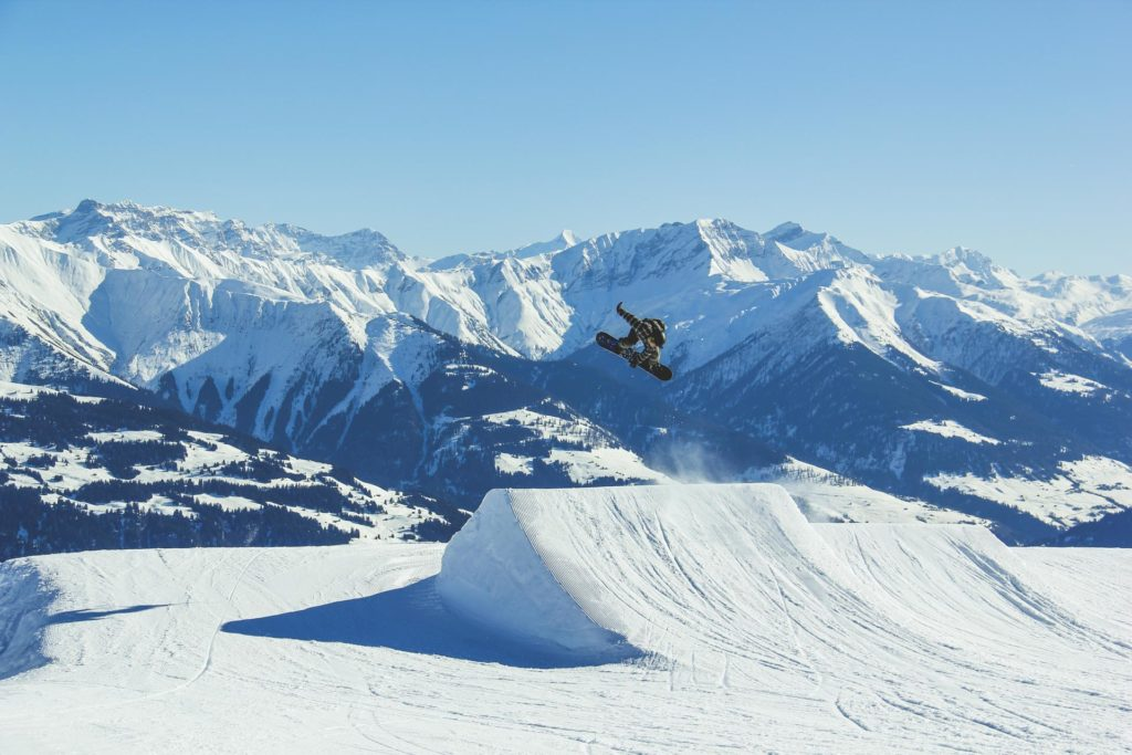 Snowboarder jumping on big jump