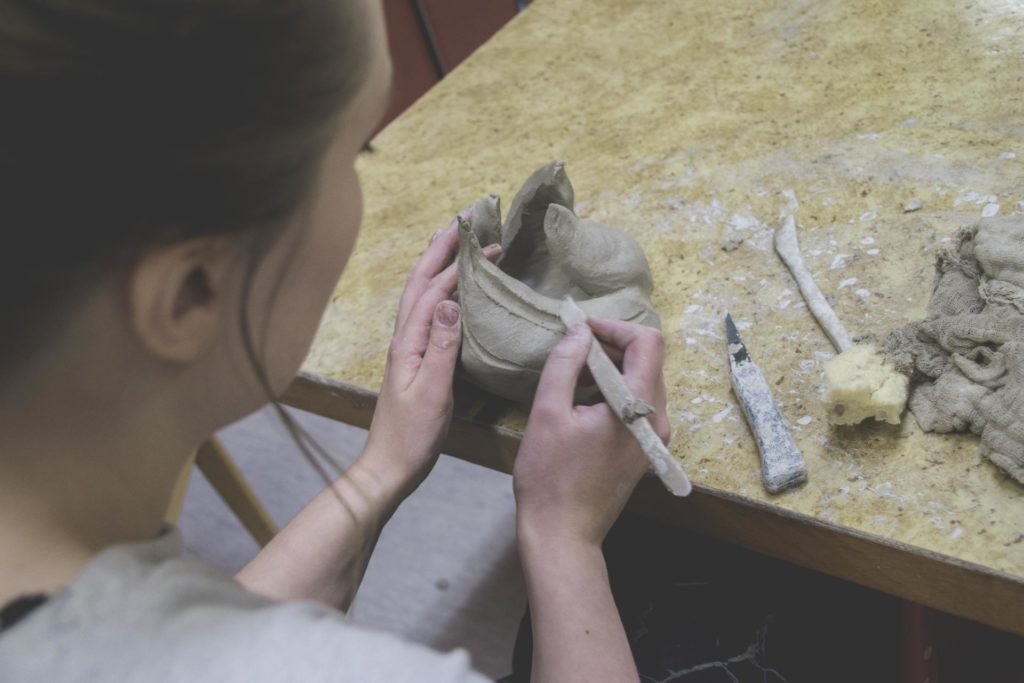 Young woman working with ceramics